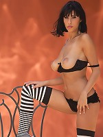 Jaime Hammer spreads her legs in striped stockings
