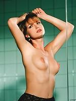 Teresa scrubs herself clean in the shower