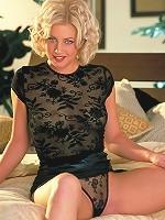 Andrea Trinity raises up her tight black mini-skirt