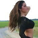 Kate posing in black fishnets topless