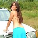 Shy brunette strips outdoors