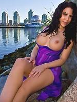 Katie Banks opens up her sexy purple dress.