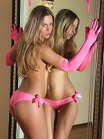 Blonde Alessandra stripteasing