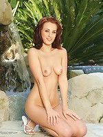 Hot redhead posing naked outdoors