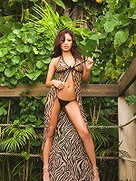 Tristen heats up the steamy, lush jungle with her sexy, sweaty bikini striptease!