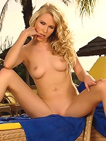 Judit - Stunning blonde rubs on pool chair