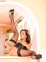 Nelli Hunter masturbates in stockings